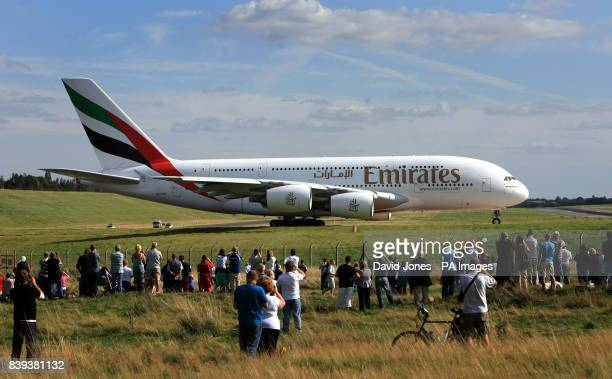 An Emirates Airbus A380 the world's largest airliner prepares to takes off from Birmingham International Airport to mark the extension of the...