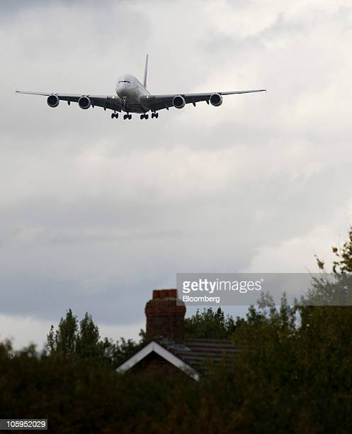 An Emirates Airline Airbus A380 airplane approaches Manchester airport in Manchester UK on Thursday Oct 21 2010 The A380 designed to carry 500 people...