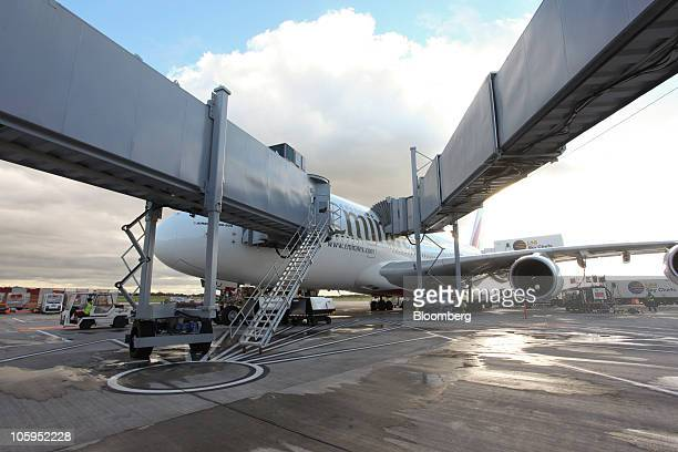 An Emirates Airline Airbus A380 airplane sits on the tarmac at Manchester airport in Manchester UK on Thursday Oct 21 2010 The A380 designed to carry...