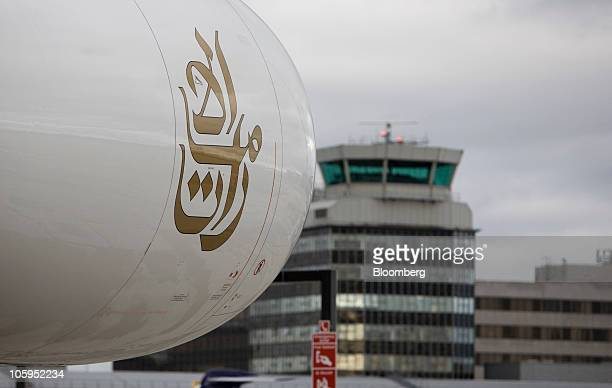 An Emirates Airline Airbus A380 engine sits against a backdrop of Manchester airport in Manchester UK on Thursday Oct 21 2010 The A380 designed to...