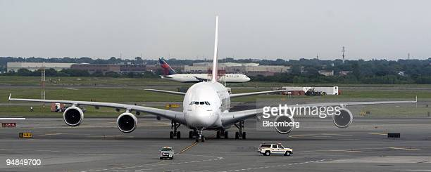 An Emirates Airline Airbus A380 jet taxis upon arriving at JFK International Airport in New York US on Friday Aug 1 2008 Emirates Airline celebrated...