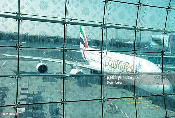 An Emirates Airline Airbus A380800 aircraft is seen on the tarmac outside terminal 3 at concourse A the new A380 terminal at Dubai International...