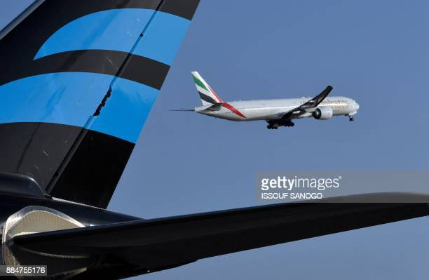 An Emirates Airline Boeing 777 aircraft takes off from the Felix HouphouetBoigny Airport in Abidjan on November 28 2017 / AFP PHOTO / ISSOUF SANOGO