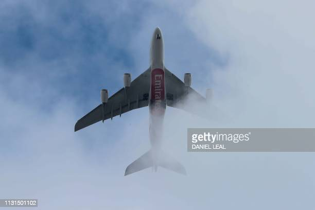 An Emirates Airlines passenger jet over-flies central London on March 19, 2019.