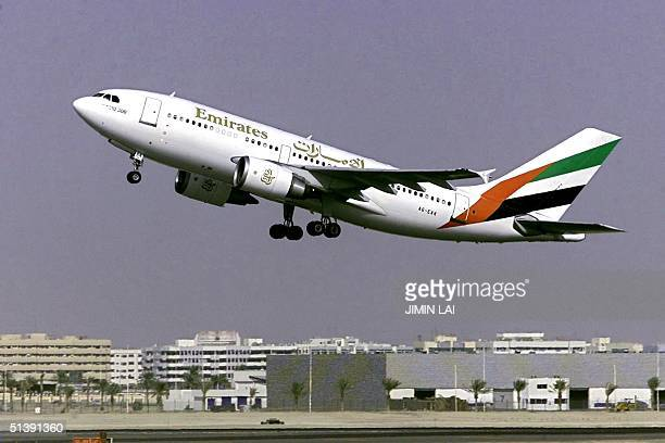 An Emirates Airlines plane takes off from the Dubai International Airport 18 October 2001 AFP PHOTO/Jimin LAI