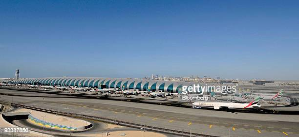 An Emirates airplane taxis down the runway at the Dubai International Airport in Dubai United Arab Emirates on Tuesday Nov 24 2009 Dubai whose...