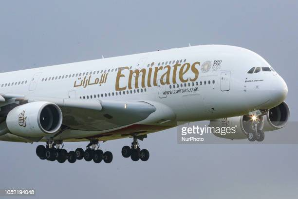 An Emirates airplane the doubledecker Airbus A380 with registration A6EOO is approaching Amsterdam Schiphol International Airport arriving at runway...