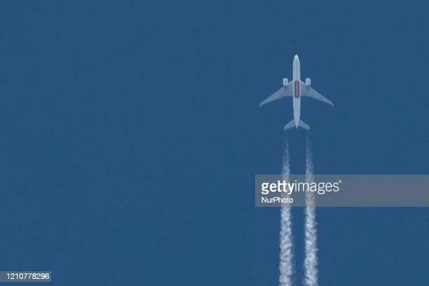 An Emirates Sky Cargo Boeing 777F aircraft as seen overflying in the Greek blue sky over the city of Thessaloniki Greece on April 23 2020 forming...