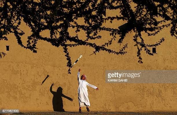 TOPSHOT An Emirati child practices a traditional dance during the third edition of the Souq alQattara festival on November 11 2016 in alAin on the...