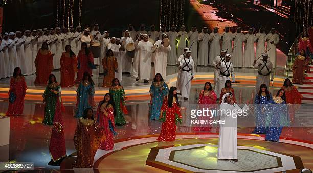 An Emirati dance troupe performs during the shooting of the awards ceremony of the 'Million Dirhams Poet' TV program in Abu Dhabi on May 21 2014 The...