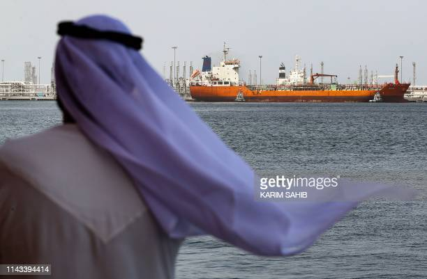 An Emirati man looks on at the port of Fujairah in the Gulf Emirate, on May 13, 2019.
