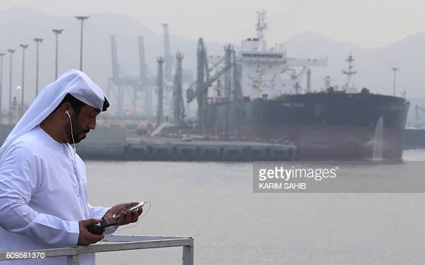 An Emirati man stands at the oil terminal of Fujairah during the inauguration ceremony of a dock for supertankers on September 21 2016 The oil...
