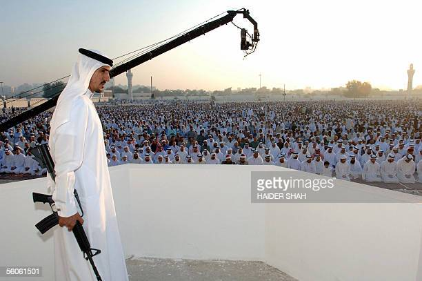 An Emirati royal security guard monitors the area where members of the United Arab Emirates' royal family attended the Eid alFitr prayer at the Grand...