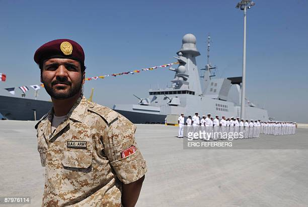 An Emirati soldier stands guard in front of the French navy fregate 'Forbin' during the inauguration by French President Nicolas Sarkozy and Emirati...