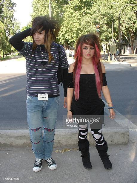 An Emo boy and girl with pink dyed hair looking serious on the street Santiago Chile 2007
