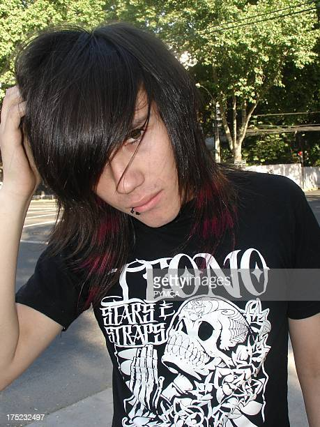 An Emo boy with red stripes dyed into his hair poses for the camera Santiago Chile 2007