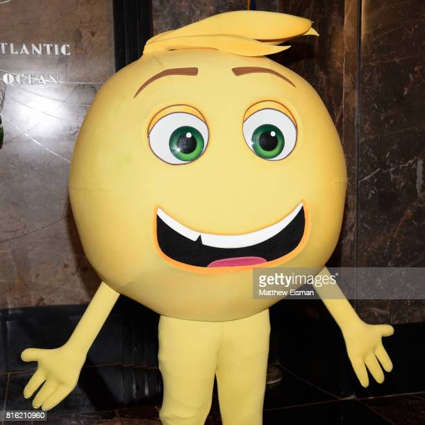 An emoji character from the film The Emoji Movie poses for a photo to celebrate World Emoji Day at The Empire State Building on July 17 2017 in New...