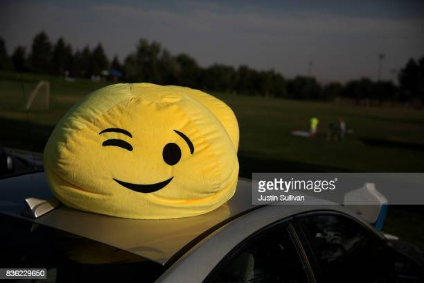 An emoji stuffed toy sits on the roof of a car at South Mike Sedar Park on August 21 2017 in Casper Wyoming Millions of people have flocked to areas...