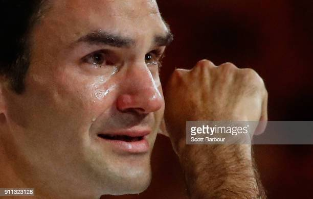 An emotioinal Roger Federer of Switzerland wipes away a tear as he poses with the Norman Brookes Challenge Cup after winning the 2018 Australian Open...