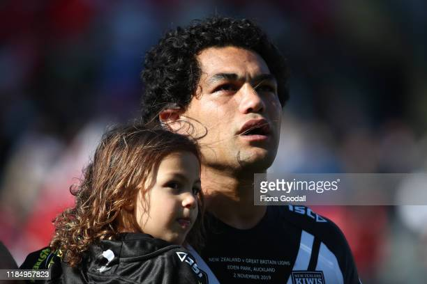 An emotional Adam Blair of the Kiwis with his children during the national anthem during the International Rugby League Test Match between the New...
