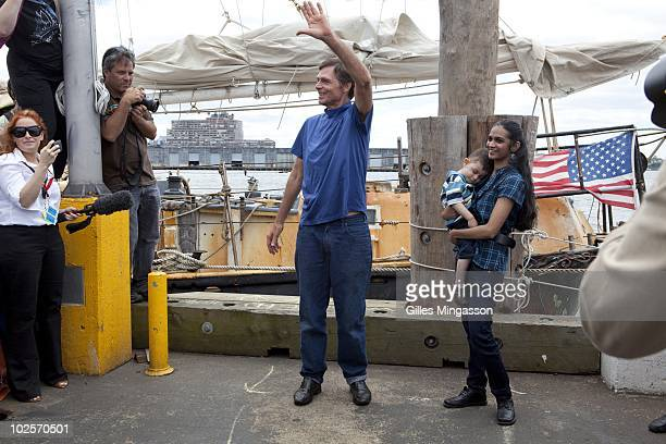An emotional American sailor Reid Stowe greets the crowd as he walks on land for the first time after 1152 days at sea at the helm of his handbuilt...