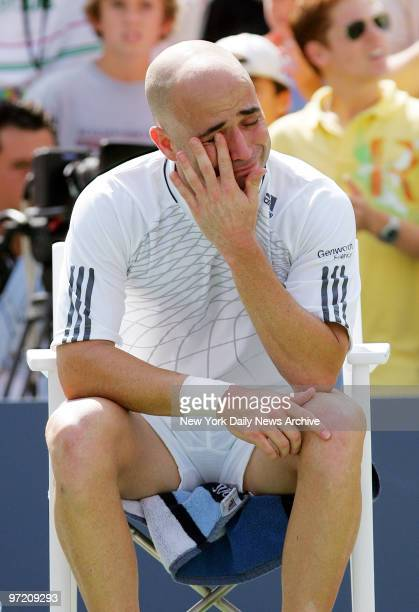An emotional Andre Agassi is seated after his loss to Benjamin Becker during his third-round match in the 2006 U.S. Open at Arthur Ashe Stadium in...