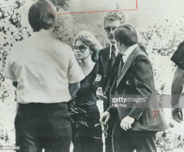 An emotional AnnMargret is escorted by her husband Roger Smith to the mausoleum for the final services at Elvis Presley's funeral in Memphis...