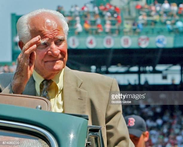 An emotional Bobby Doerr Hall of Fame Boston Red Sox second baseman waves to cheering fans as he rides off the field following a pregame ceremony...