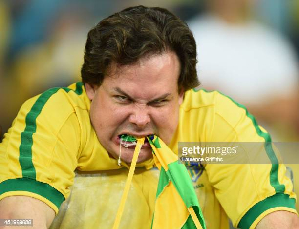 An emotional Brazil fan reacts after being defeated by Germany 71 after the 2014 FIFA World Cup Brazil Semi Final match between Brazil and Germanyat...