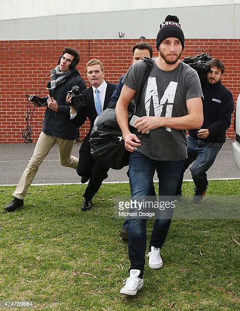 An emotional Dale Thomas of the Blues leaves after the sacking of Blues head coach Michael Malthouse during a Carlton Blues AFL press conference at...