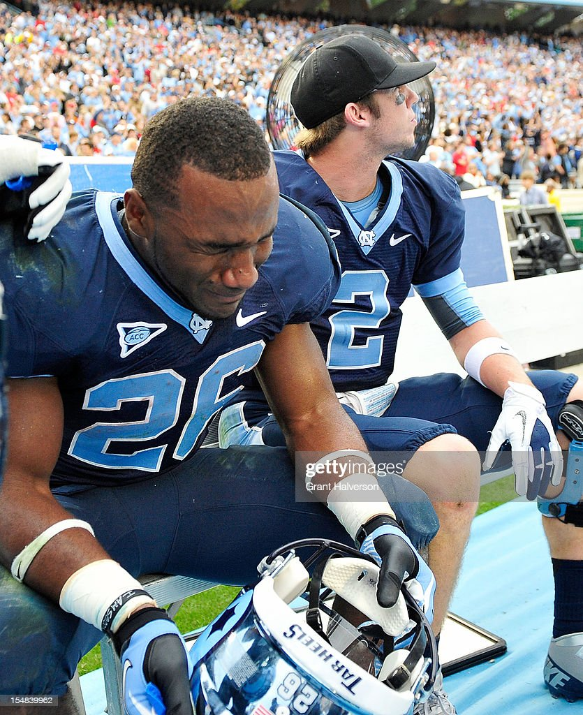 An emotional Giovani Bernard #26 sits on the bennch with Bryn Renner #2 of the North Carolina Tar Heels after scoring the game-winning touchdown on a punt return against the North Carolina State Wolfpackt Kenan Stadium on October 27, 2012 in Chapel Hill, North Carolina. North Carolina won 43-35.