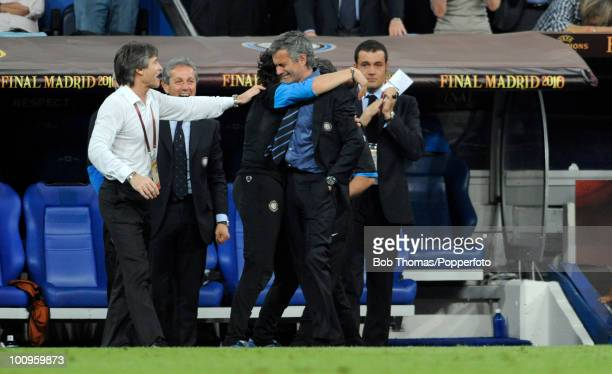 An emotional Inter Milan manager Jose Mourinho close to tears is congratulated by team officials during injury time of the UEFA Champions League...