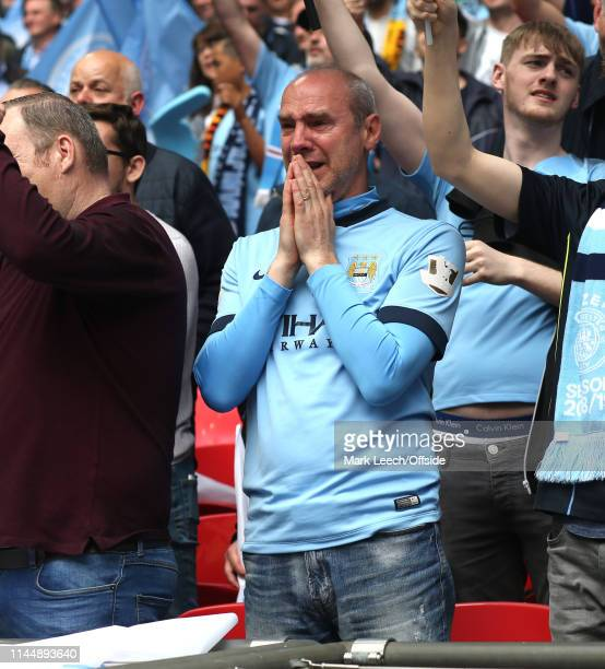 an emotional Manchester City fan during the hymn 'Abide with me' prior to the FA Cup Final match between Manchester City and Watford at Wembley...