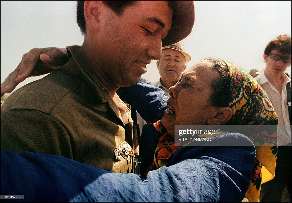 An emotional mother embraces her son, a Soviet soldier (L) who has just crossed the Soviet-Afghan border 21 May 1988 in Termez, during the withdrawal of Soviet army from Afghanistan. The Soviet Union invaded Afghanistan in December 1979 to shore up the pro-Soviet regime in Kabul and maintained more than 100,000 troops in the country until completing their phased withdrawal in 1989.