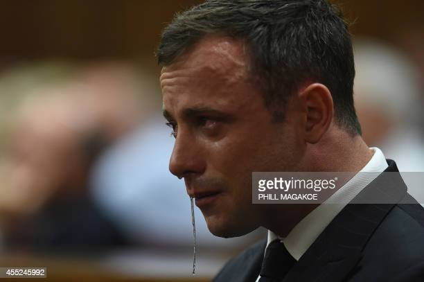 An emotional Oscar Pistorius is seen in the dock as judgment is handed down in his murder trial at the High Court in Pretoria on September 11, 2014....