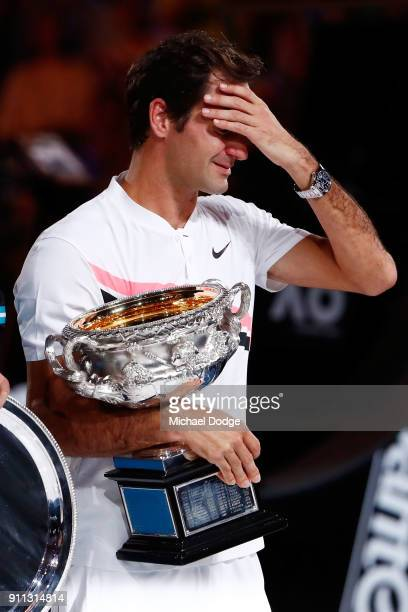 An emotional Roger Federer of Switzerland poses with the Norman Brookes Challenge Cup after winning the 2018 Australian Open Men's Singles Final...
