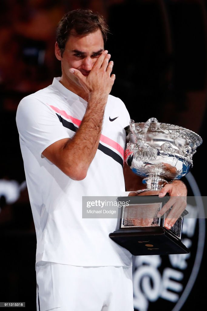 An emotional Roger Federer of Switzerland poses with the Norman Brookes Challenge Cup after winning the 2018 Australian Open Men's Singles Final against Marin Cilic of Croatia on day 14 of the 2018 Australian Open at Melbourne Park on January 28, 2018 in Melbourne, Australia.