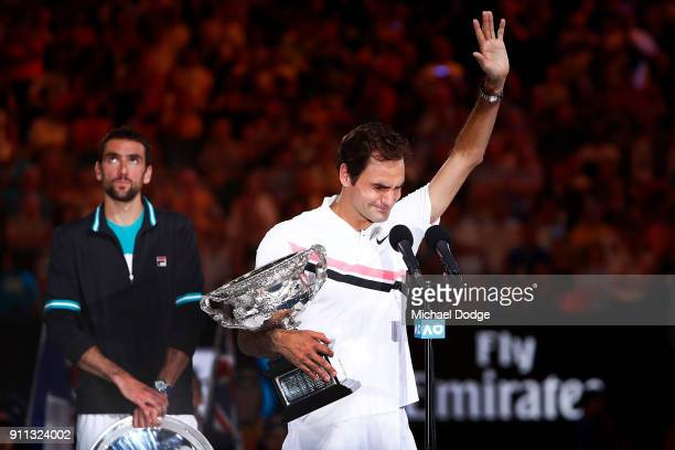 An emotional Roger Federer of Switzerland speaks on stage with the Norman Brookes Challenge Cup after winning the 2018 Australian Open Men's Singles...