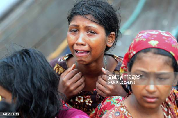 An emotional Rohingya Muslim woman fleeing sectarian violence in Myanmar is pictured on an intercepted boat trying to cross the Naf river into...