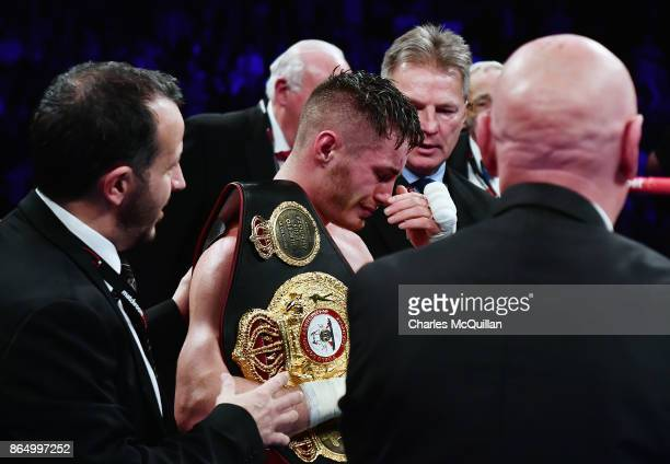 An emotional Ryan Burnett of Northern Ireland celebrates after his bout with Zhanat Zhakiyanov of Kazakhstan for the IBF WBO and IBO World...