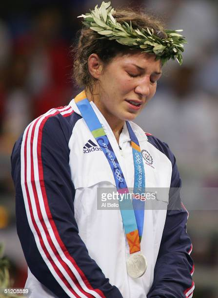 An emotional Sara McMann of the USA winner of the Silver medal stands on the podium after the women's Freestyle wrestling 63 kg event on August 23,...