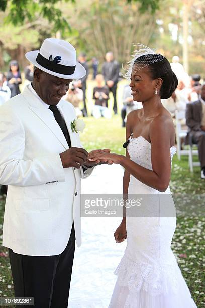 An emotional South African National Police Commissioner Bheki Cele and his new wife Thembeka Ngcobo exchange rings at their wedding held at the elite...