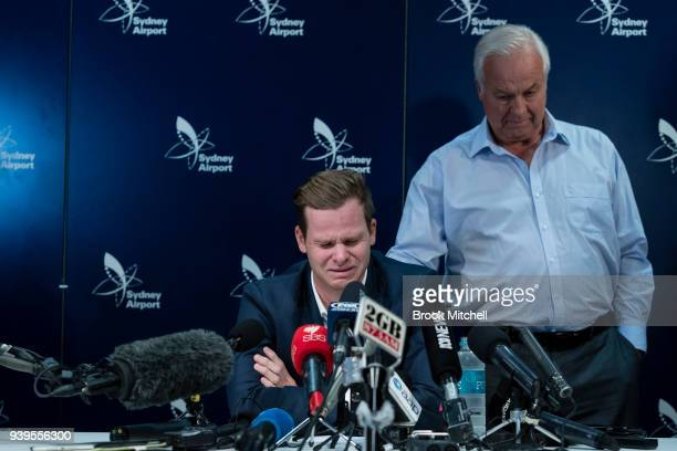 An emotional Steve Smith is comforted by his father Peter as he fronts the media at Sydney International Airport on March 29, 2018 in Sydney,...