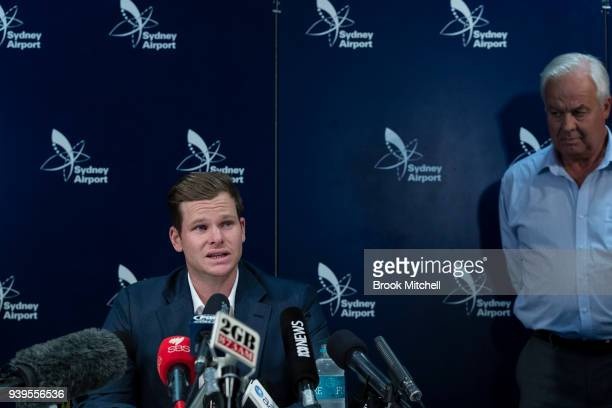 An emotional Steve Smith is comforted by his father Peter as he fronts the media at Sydney International Airport on March 29 2018 in Sydney Australia...