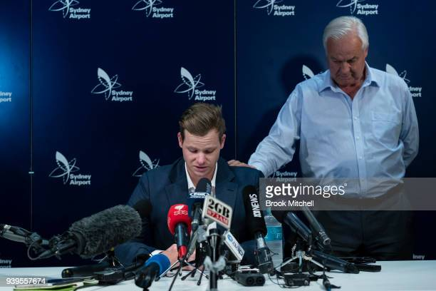 An emotional Steve Smith is comforted by his father Peter as he confronts the media at Sydney International Airport on March 29 2018 in Sydney...