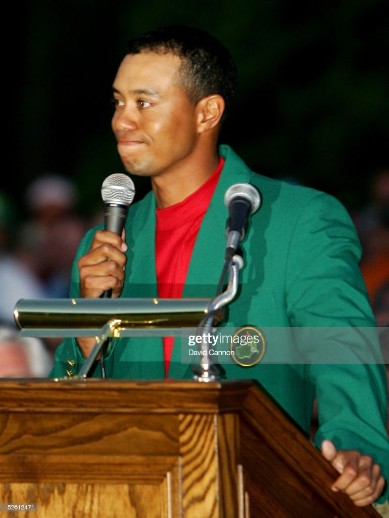 An emotional Tiger Woods speaks at the podium after receiving the green jacket and winning The Masters at the Augusta National Golf Club on April 10, 2005 in Augusta, Georgia.