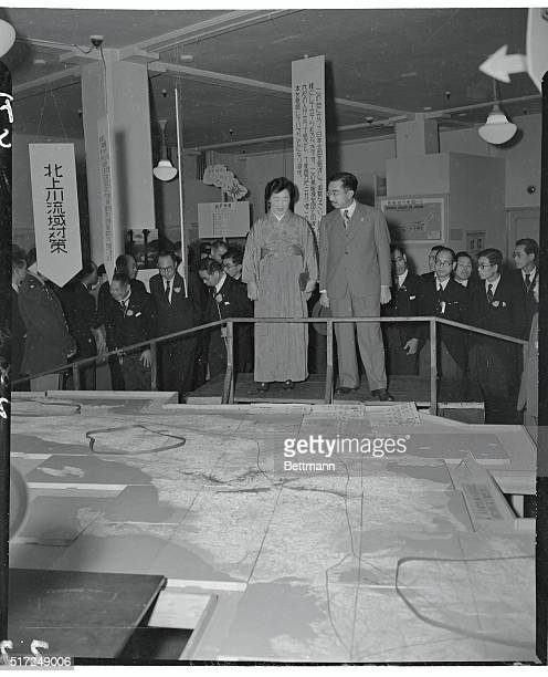 An Emperor Hobnobs with the Crowd Tokyo Japan Emperor Hirohito and his Empress Nagako who since the allied occupation have established themselves as...