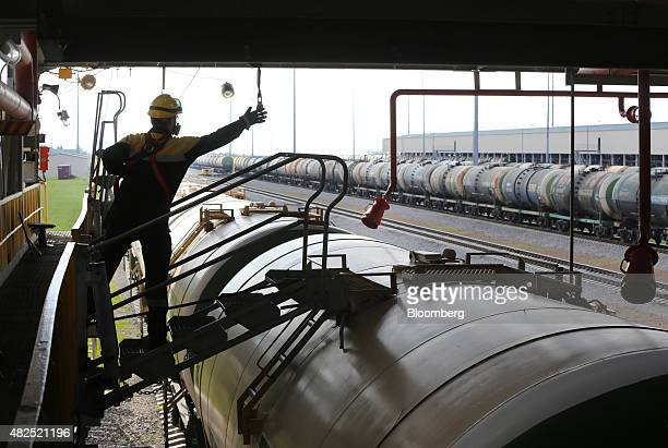 An employee accesses a freight wagon filled with petroleum fuel ahead of shipping at the 'TANECO' refining and petrochemical plant operated by...