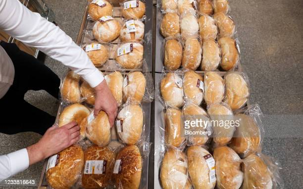 An employee adjusts a display of fresh bread in a Morrisons supermarket, operated by Wm Morrison Supermarkets Plc, in Saint Ives, U.K., on Monday,...