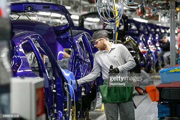 An employee adjusts a Nissan Juke on the production line at the Nissan Motor Co production plant in Sunderland UK on Thursday Dec 3 2015 Nissan rose...